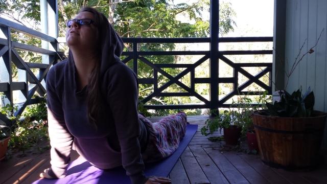 Pyjamas, balcony, yoga (the mat belonged to my friend)